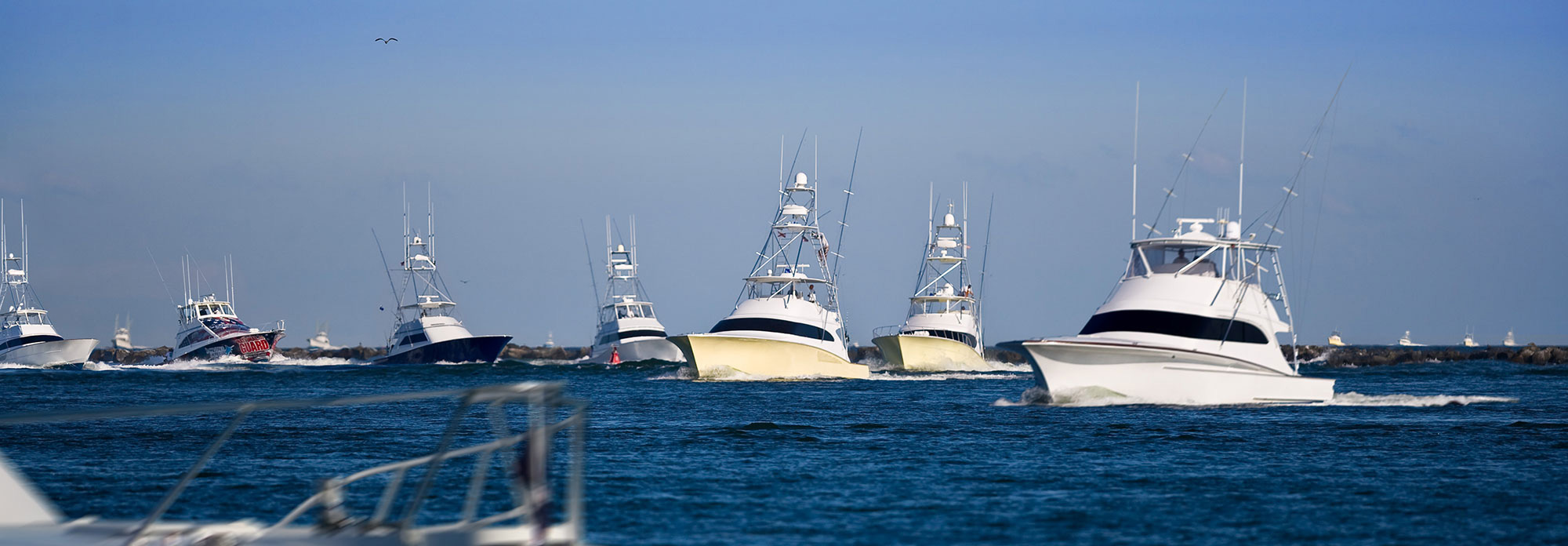 multiple offshore fishing boats in ocean city inlet